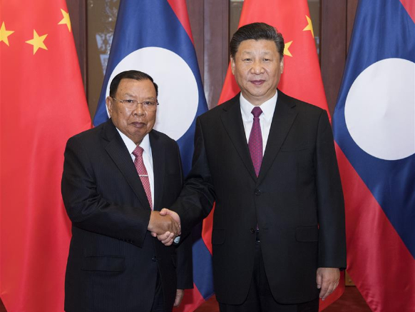 Xi says China to continue all-out support for Laos' COVID-19 fight