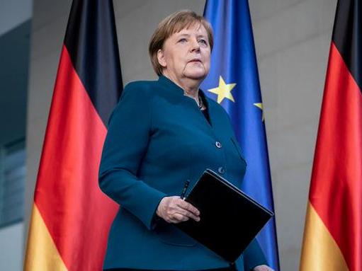 Germany's Merkel returns to office after quarantine stint
