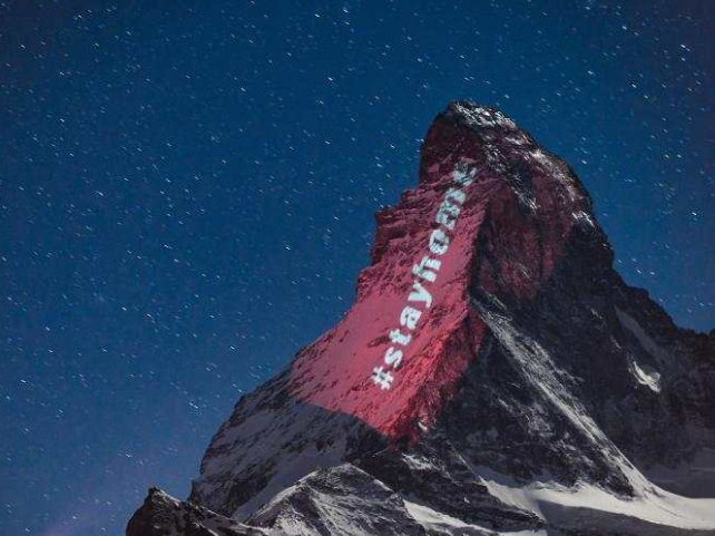 'Stay home'! Switzerland's Matterhorn lit with inspirational messages