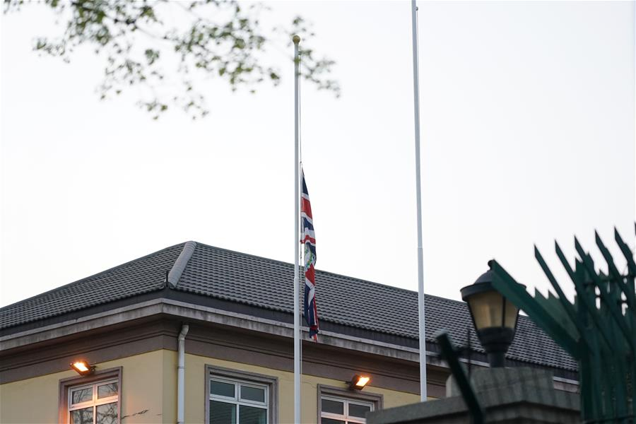 Foreign embassies in China lower flags, mourn for COVID-19 victims
