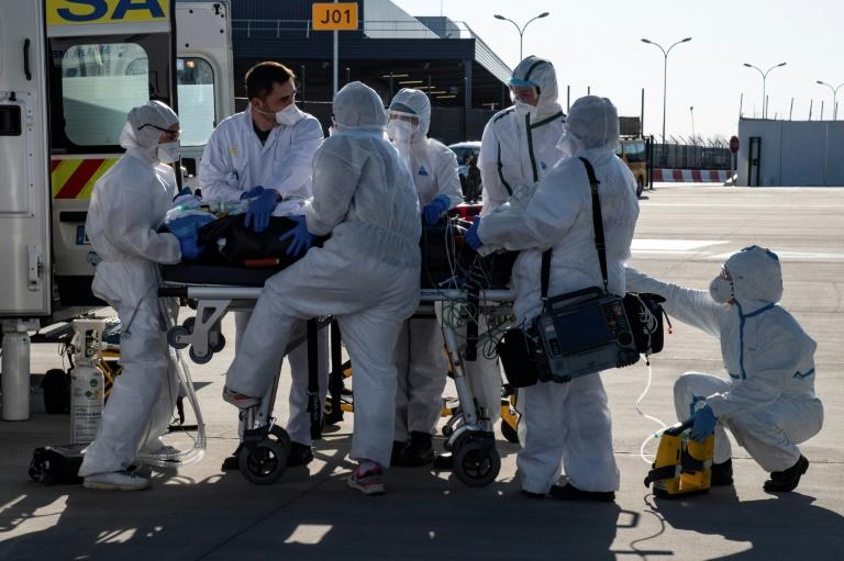 Trump warns 'toughest week' ahead as global virus deaths top 60,000