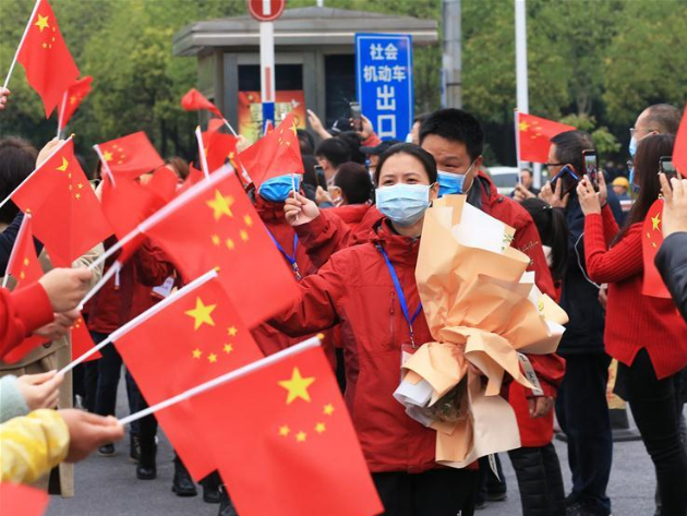 Medics supporting virus-hit Hubei return to positions in Hunan