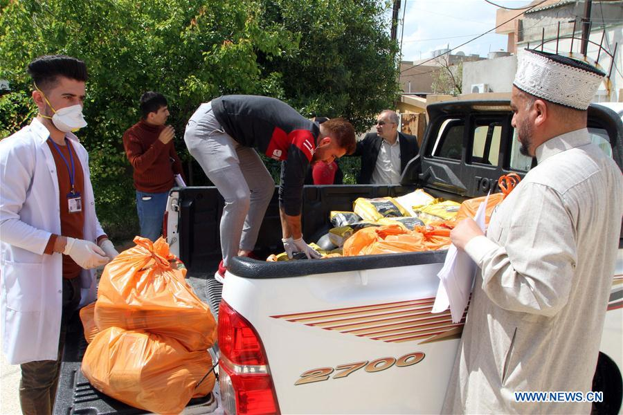 Charity organization distributes food to poverty stricken people in Kirkuk, Iraq