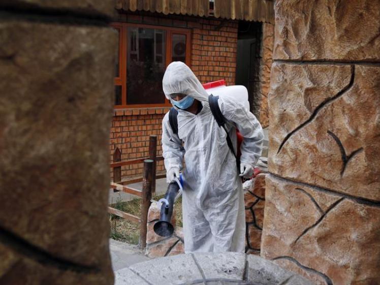 Workers take measures amid COVID-19 outbreak in Sanaa, Yemen