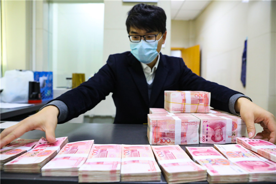 China implements lower interest rate on excess reserves for banks