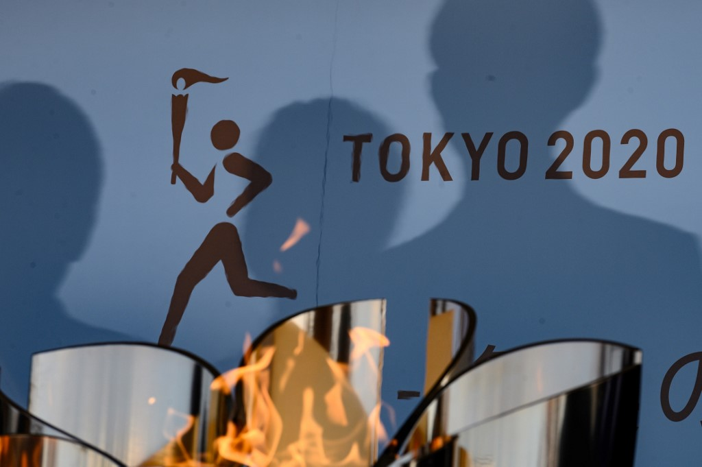 Japan ends Olympic flame display due to virus