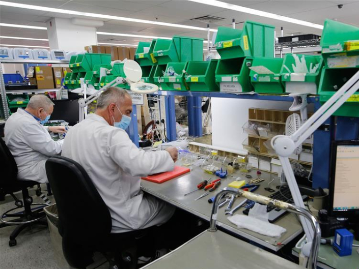Israeli engineers work in production line of ventilators