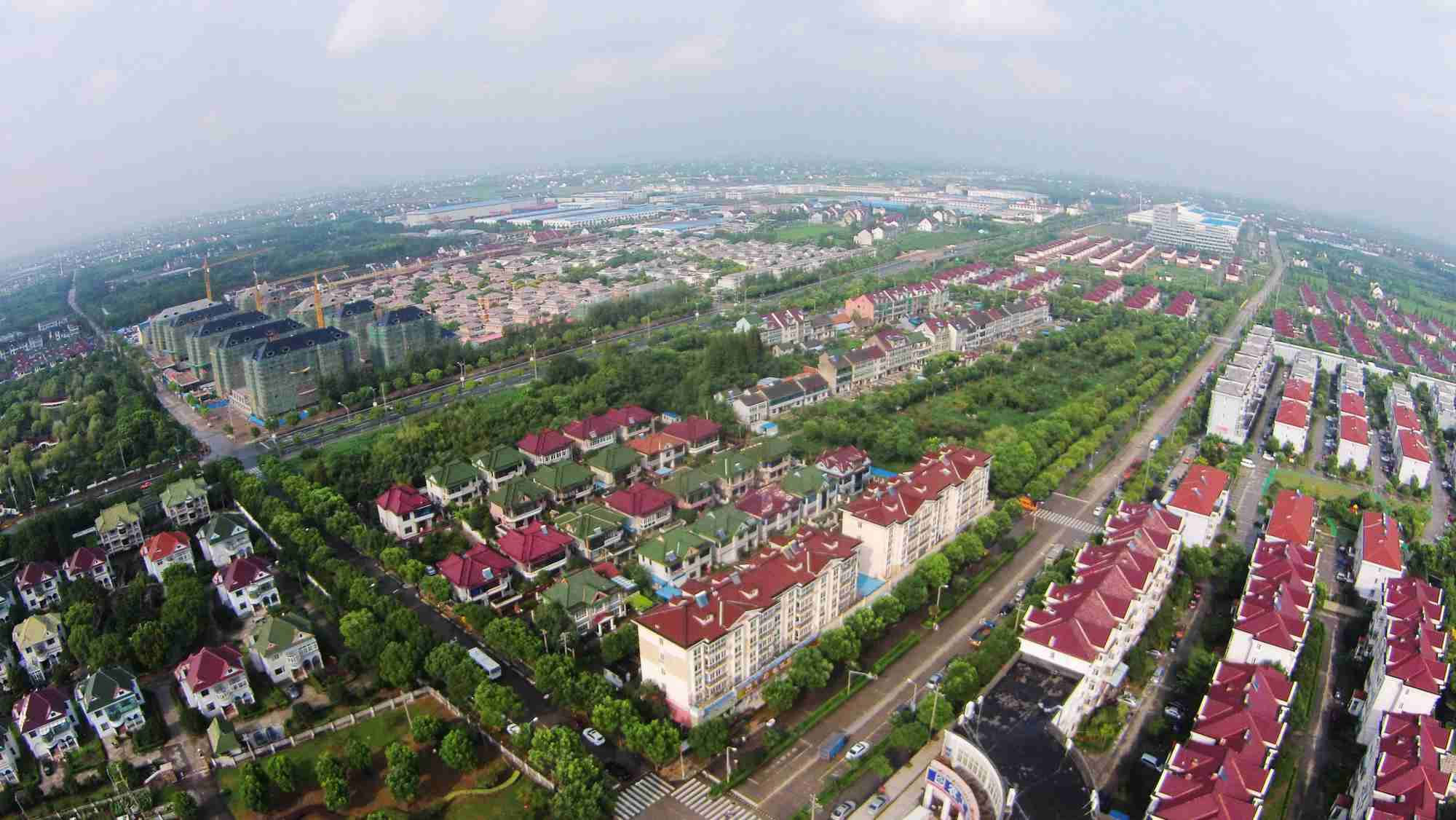 China to ease urban residency restrictions to boost urbanization