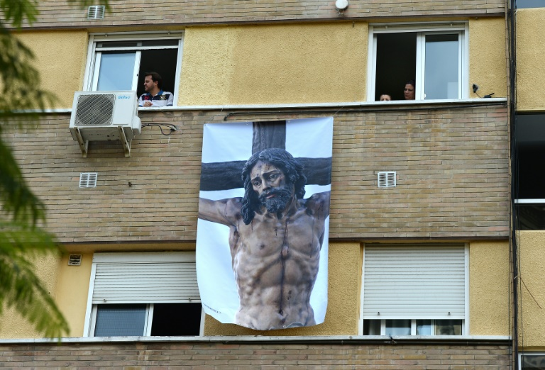 Locked-down Spain celebrates Holy Week with music and humour