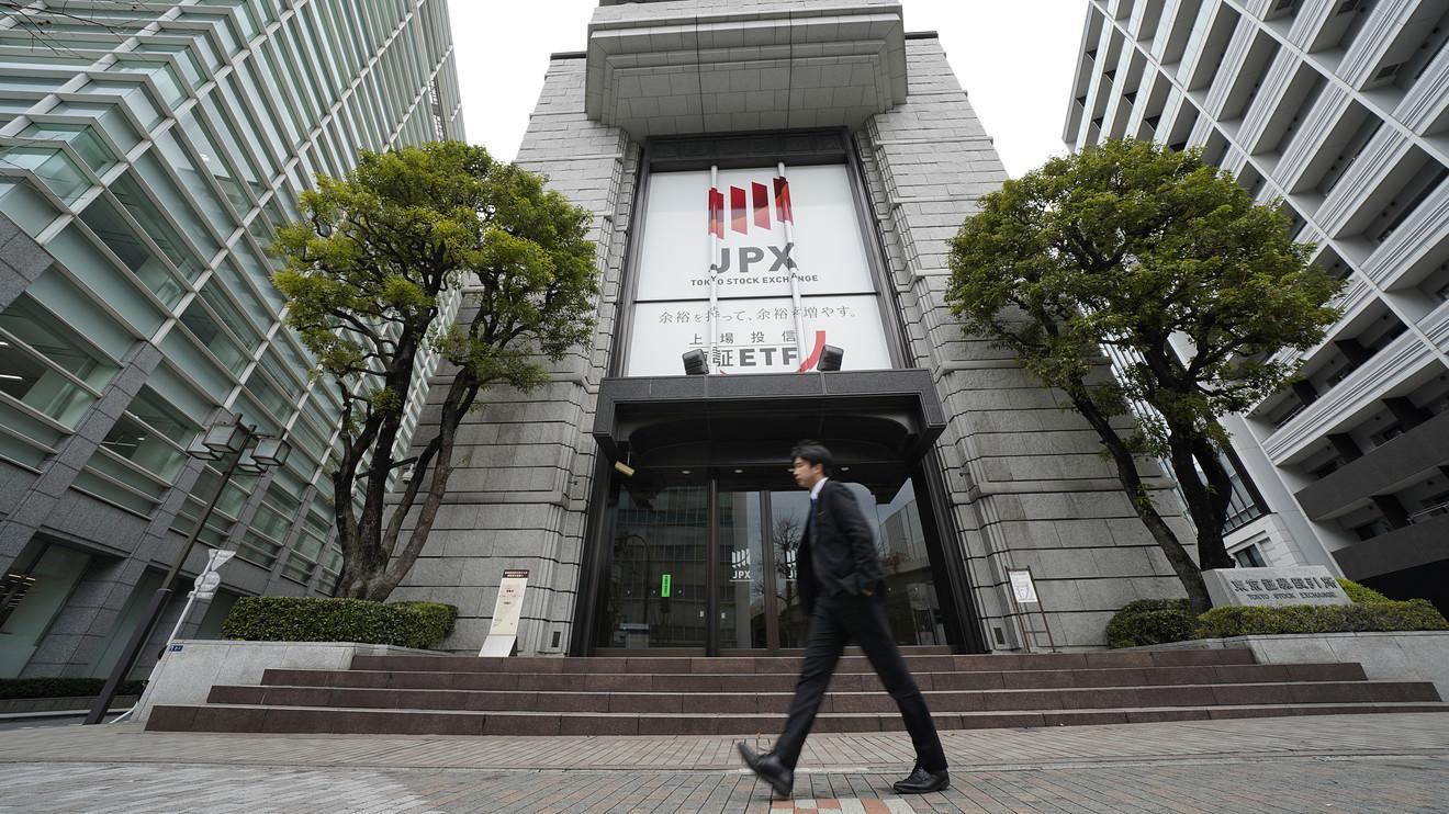 Tokyo stocks open mixed on Wall Street's rise, coronavirus woes