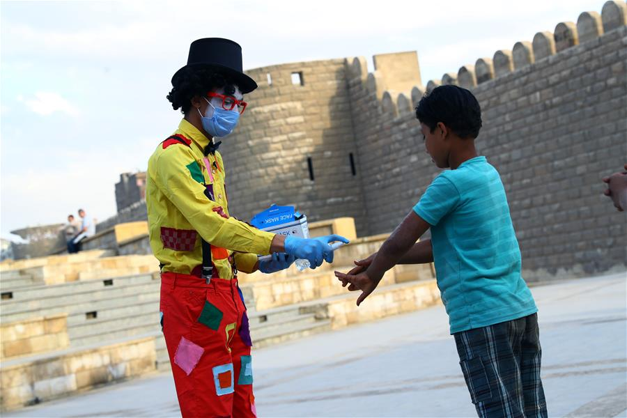 Student wearing clown clothes raises people's awareness on COVID-19 in Cairo