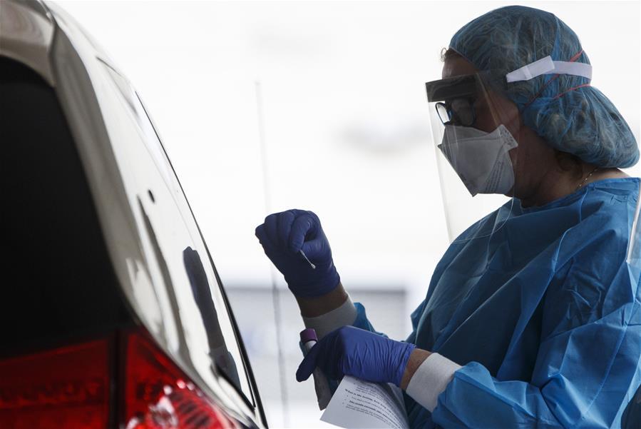 Medical workers take samples at drive-thru testing site in George Washington University Hospital