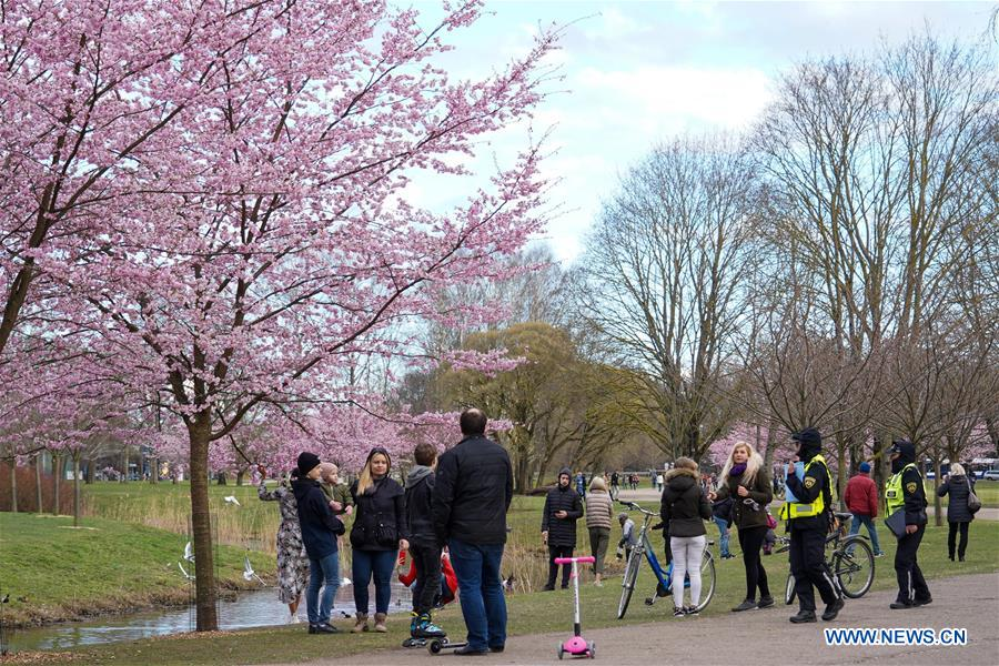 People enjoy spring scenery in Riga, Latvia