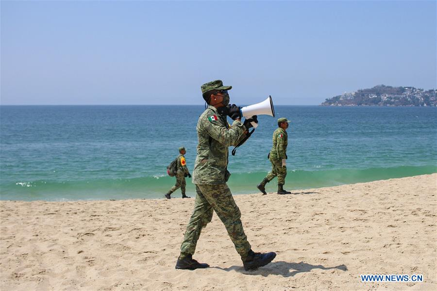 Soldiers patrol on beach closed due to COVID-19 pandemic in Mexico