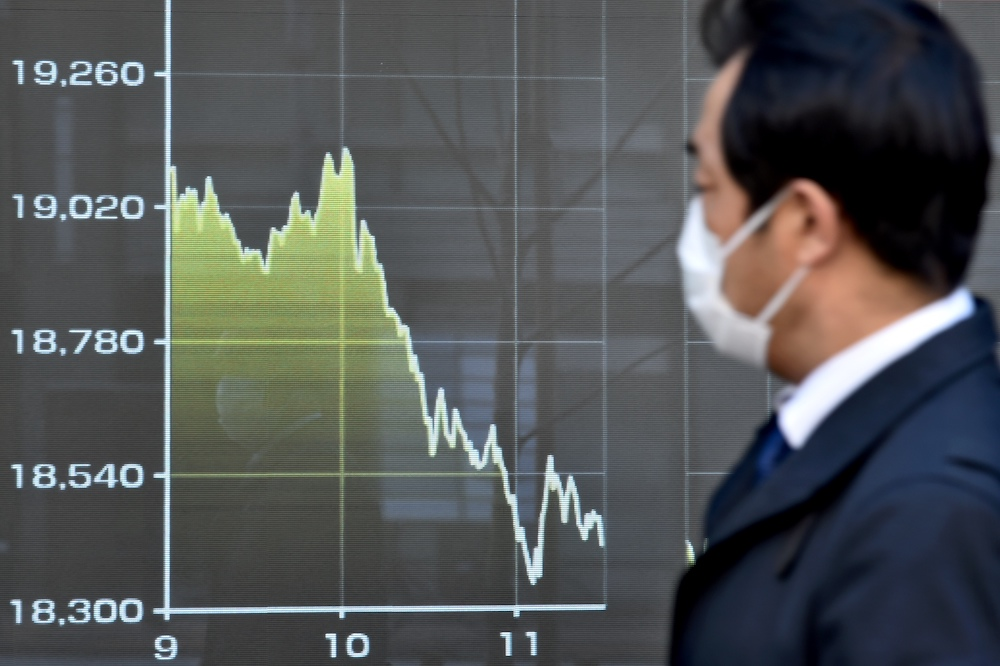 Asia markets down as oil rallies on output cuts deal