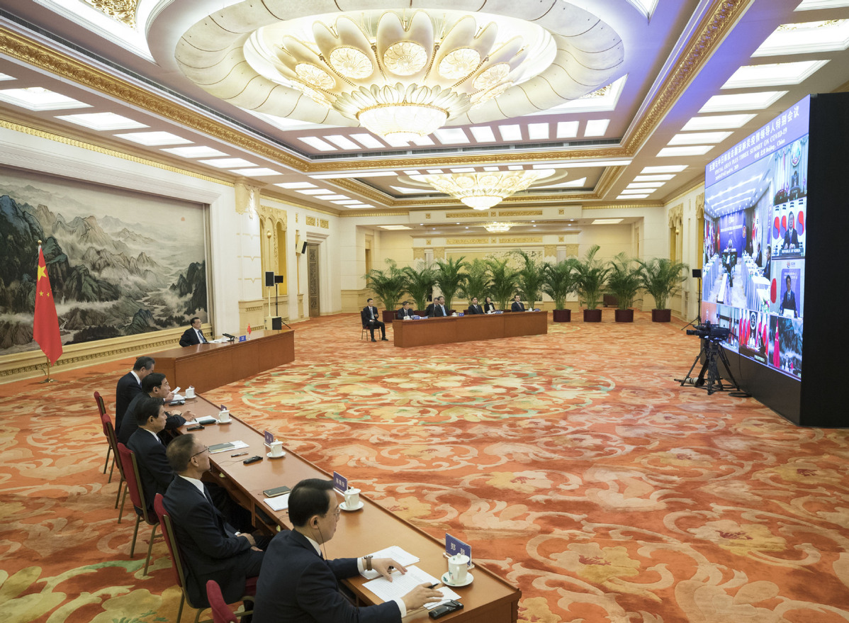 Chinese premier proposes fast-track lane for essential personnel on urgent visits