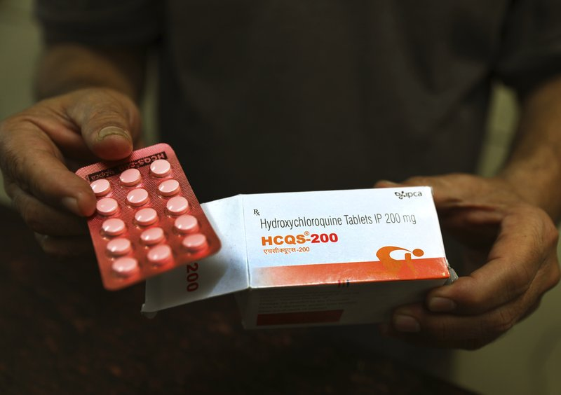 Heart woes spur partial stop of malaria drug study for virus