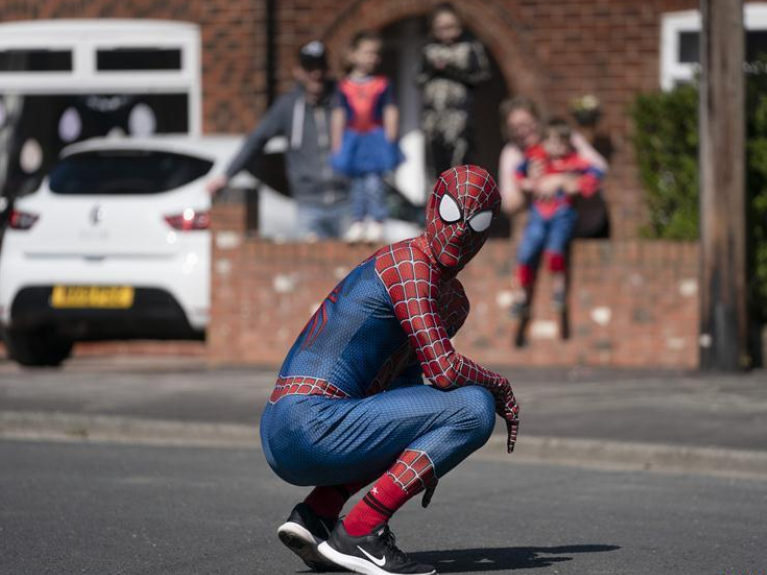 'Spider-Man' entertains public amid COVID-19 outbreak in Manchester, Britain