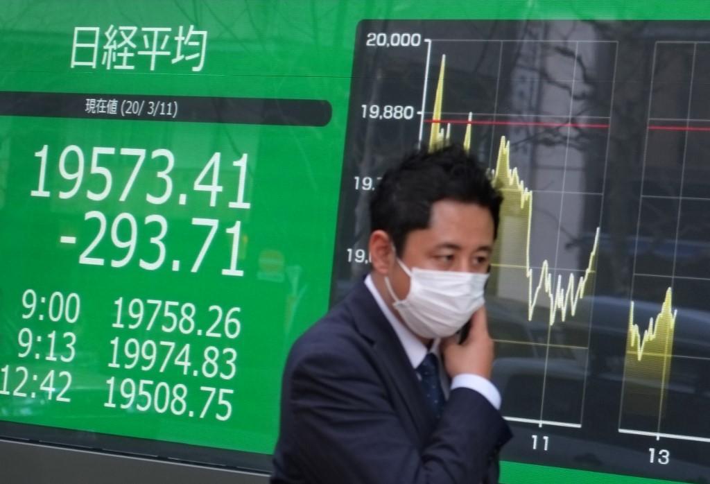 Tokyo stocks open lower on stronger yen
