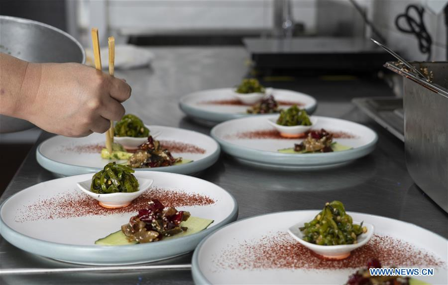 Catering businesses in Chengdu provide serving spoons and chopsticks to promote healthier table manners