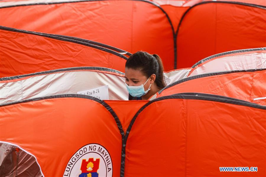 Modular tents set up for victims of residential fire in the Philippines