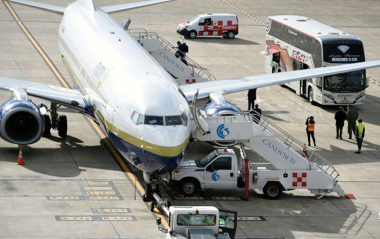 Final passengers from virus-stricken cruise ship leave Uruguay