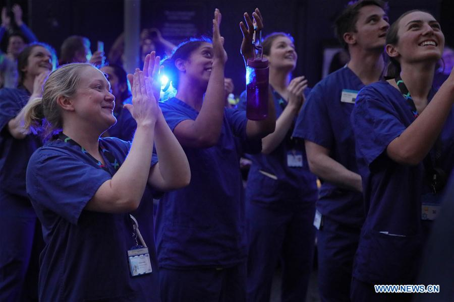 Medical workers applaud during weekly clap for NHS in London