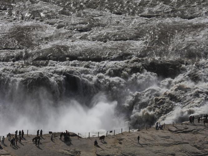 Tourists admire Hukou Waterfall in Shanxi