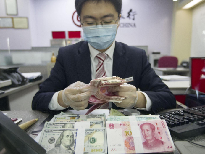 Chinese yuan weakens to 7.0718 against USD Friday