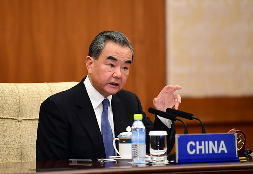 Only through solidarity can world beat COVID-19: Chinese FM