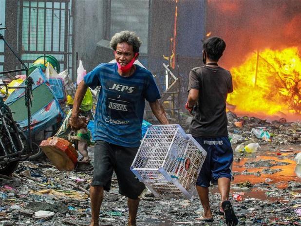Fire engulfs slum area in Manila, the Philippines