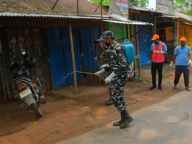 Military personnel, volunteers spray disinfectant in market during lockdown in Agartala, India