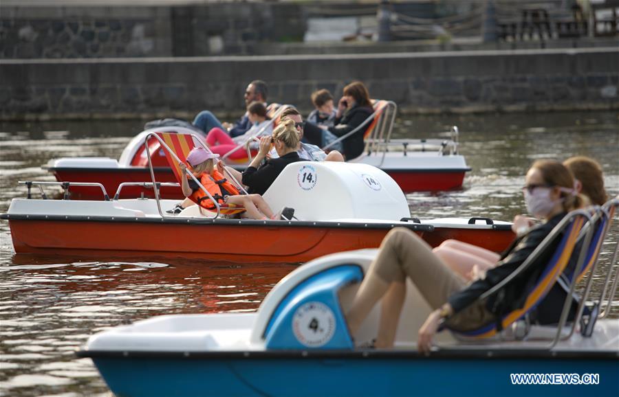 People enjoy leisure time on boats in Prague, Czech Republic