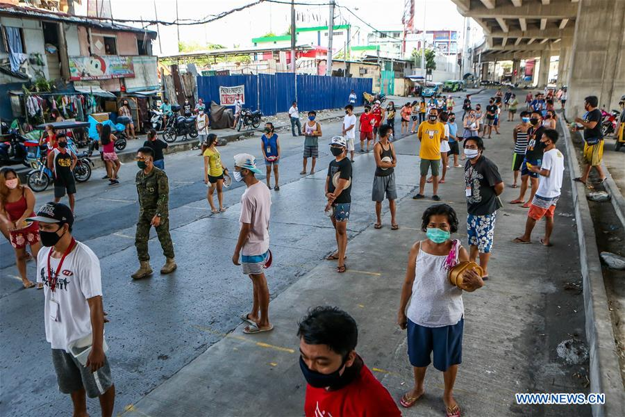 Residents of the Philippines line up for free meals in enhanced community quarantine