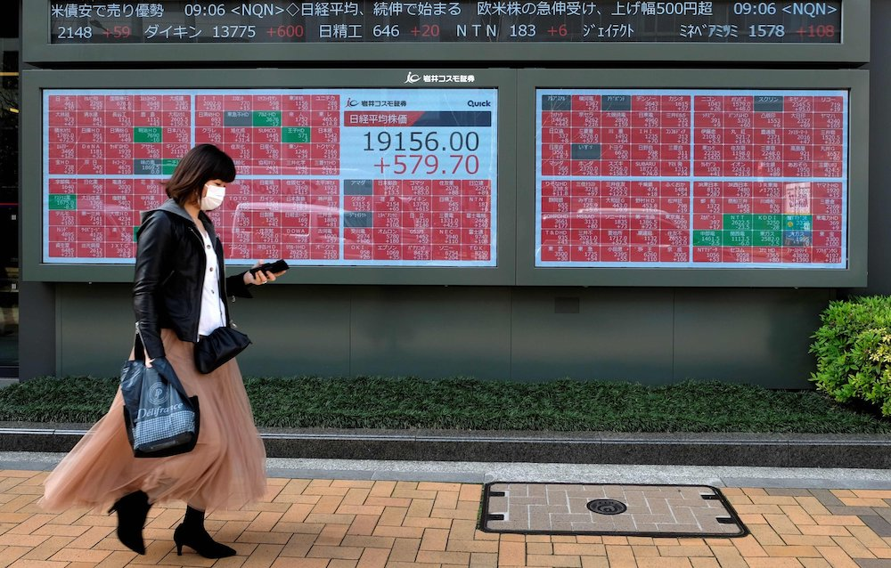 Tokyo stocks open lower with eyes on local virus cases