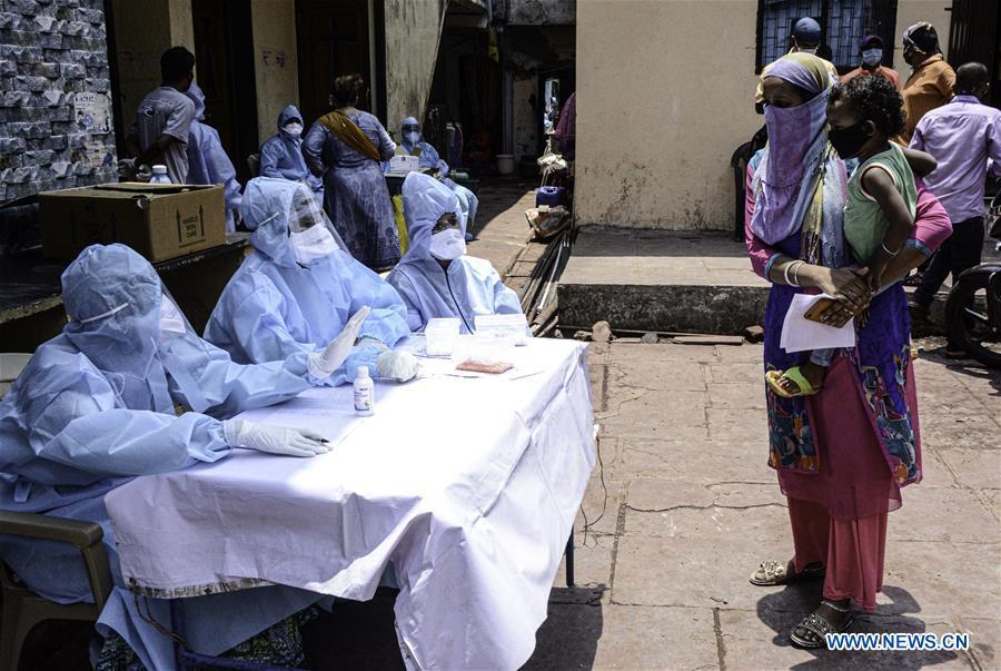 Medical staff conduct novel coronavirus tests for people at Dharavi, India