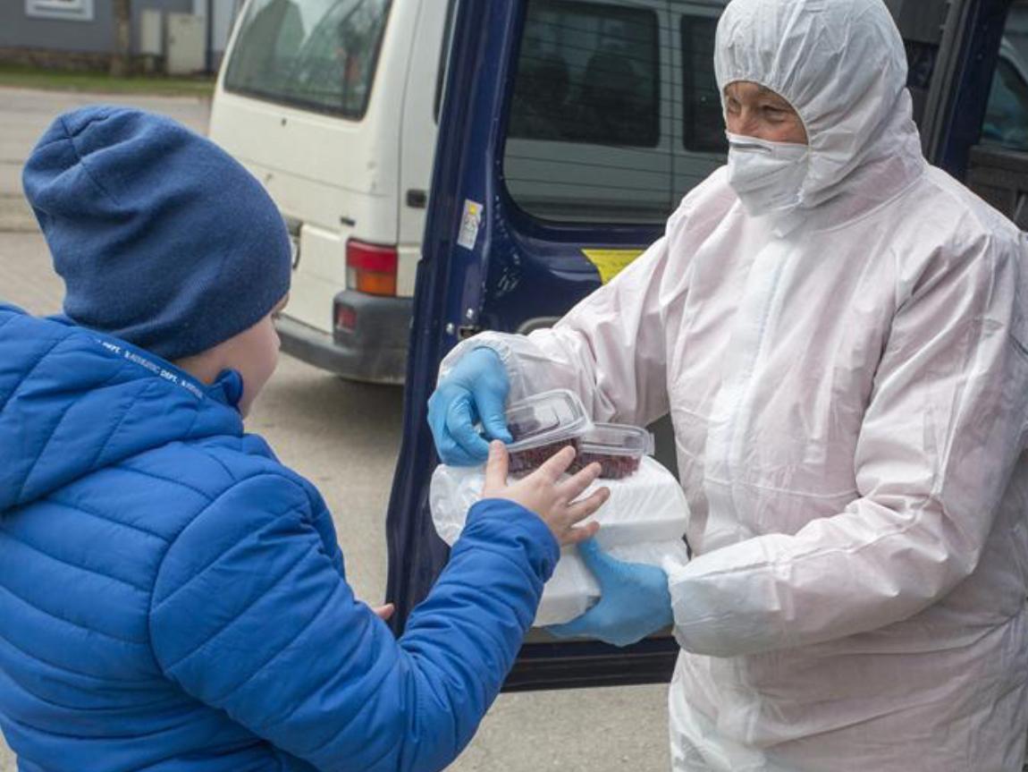 Staff members distribute free food in Ogre, Latvia
