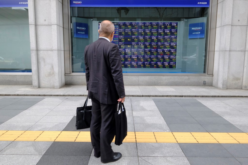 Tokyo stocks drop in morning on US crude oil futures' historic dive
