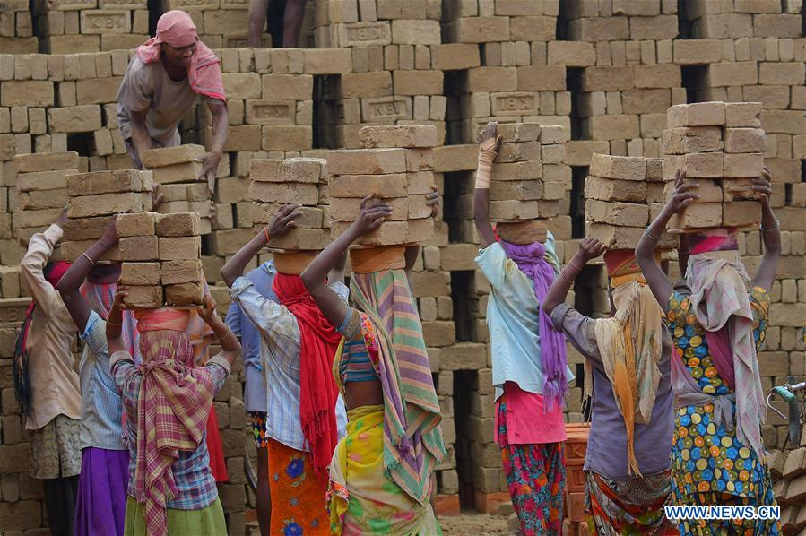 People work in brick field during government-imposed nationwide lockdown in Tripura, India