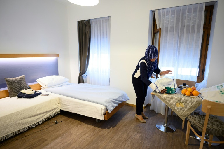 Homeless taste 'luxury' at Geneva hotel during pandemic