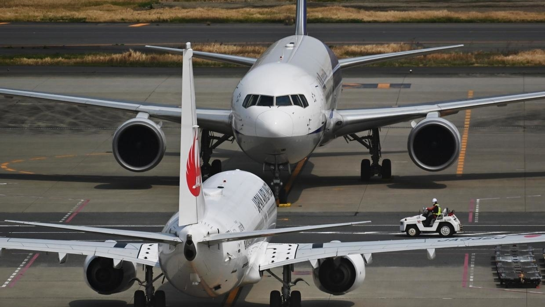 JAL cuts profit forecast more than 40% as virus bites