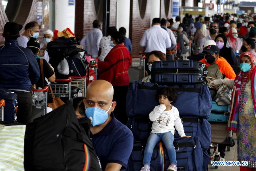 US nationals wait to return home at Hazrat Shahjalal Int'l Airport in Bangladesh