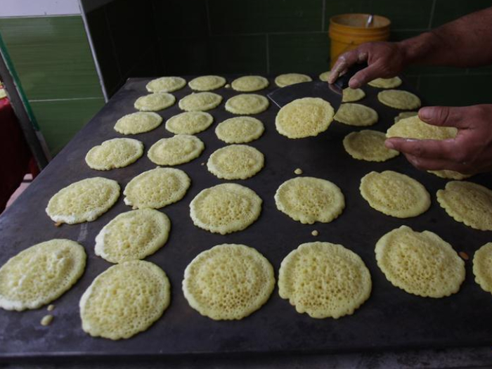 Palestinian makes traditional sweets at market in West Bank City of Nablus