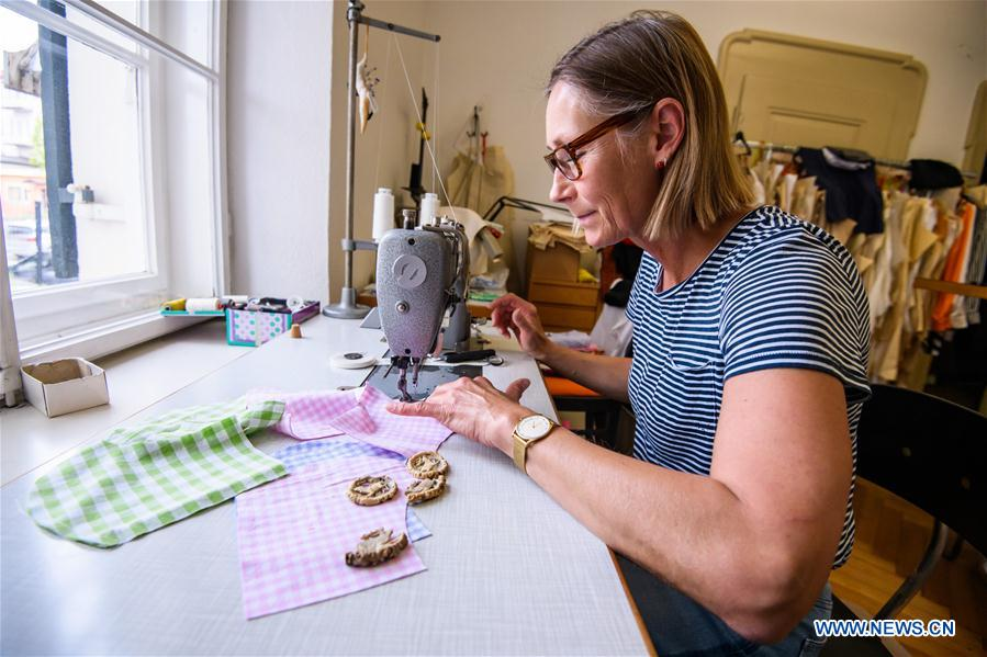 Christine makes face masks at tailor shop in Traunstein, Germany