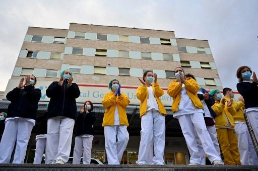 Spain sees daily coronavirus deaths fall to 301