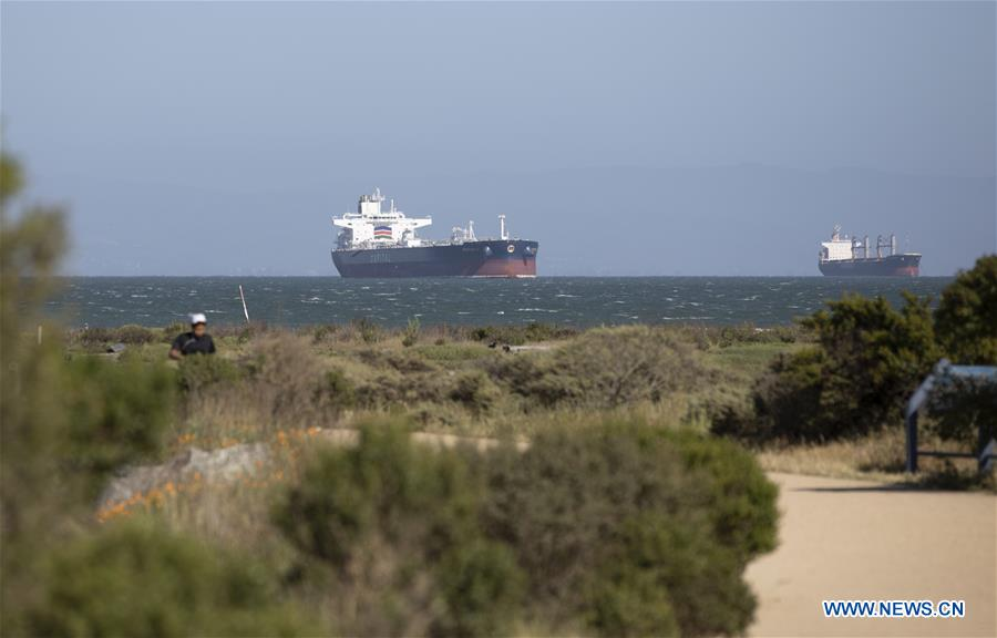 Over 30 oil tankers carrying crude oil parked between Long Beach and San Francisco Bay Area
