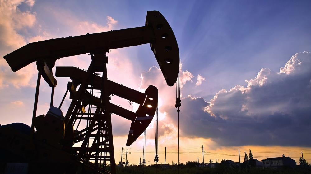 US oil jumps more than 14%, above $14 a barrel