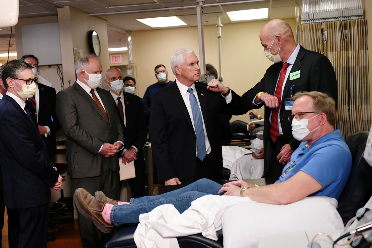US VP Pence visits clinic without mask despite policy