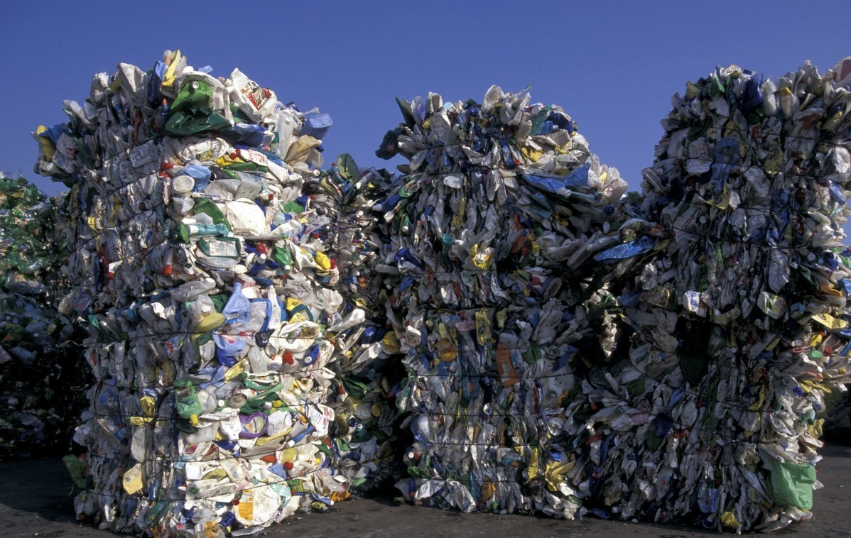 China adopts law revision to curb solid waste pollution