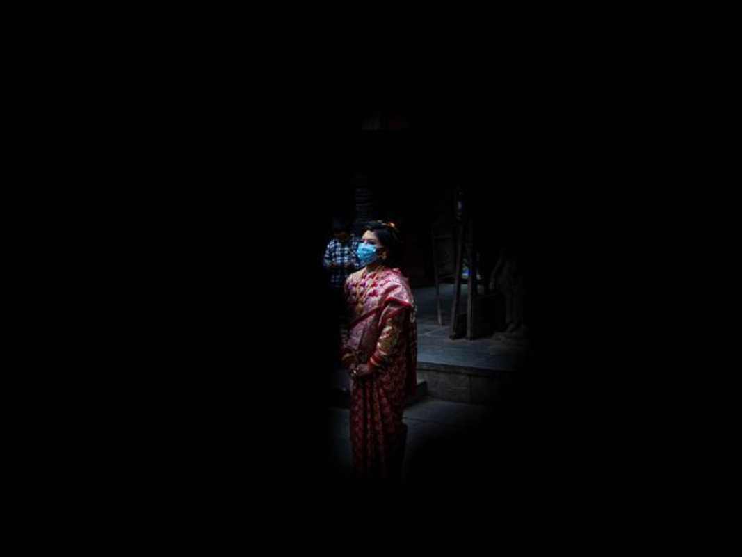 People wear face masks to attend wedding ceremony in Kathmandu, Nepal